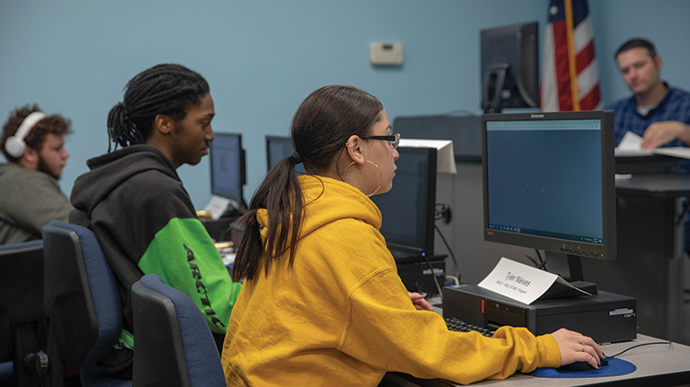 MASC Students taking notes in the computer lab